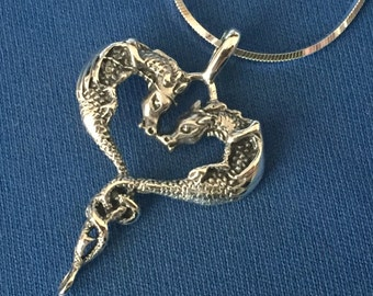 A Dragons entwined sterling Silver Locket and sterling snake chain