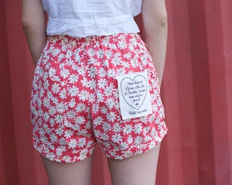 pink floral daisy shorts with forrest gump quote