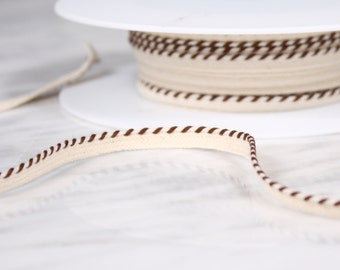 4.5 m of 6mm, cotton tape, broken and Brown, white (4581)