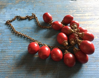 Antique choker necklace of dangling red beads with gilt brass findings
