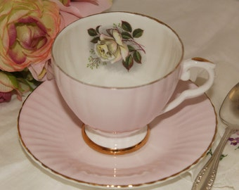 Consort: Very light pink tea cup and saucer, with white rose