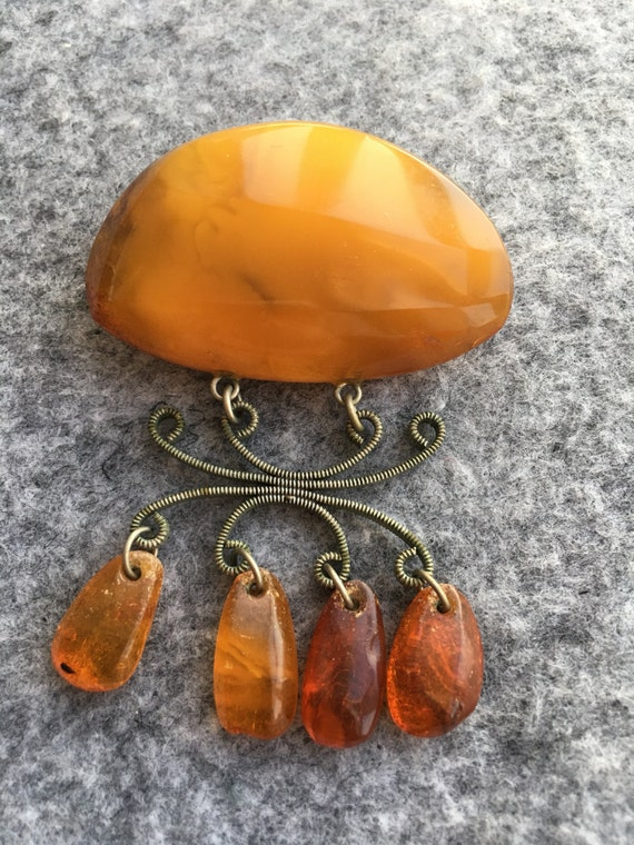 Antique natural honey amber brooches