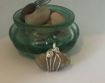 Isle of Wight pebble wrapped in silver plated wire
