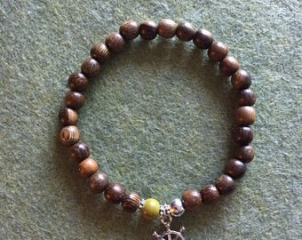 Wood beaded stretch bracelet with nautical ship wheel charm