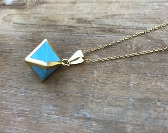 "Tiny Turquoise Octahedron Pendant with Gold Trim on matching 18"" Gold Necklace Chain"