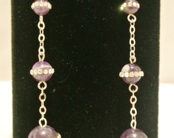 purple glass beads with crystals around