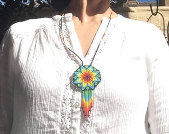 Huchol necklace art from mexico