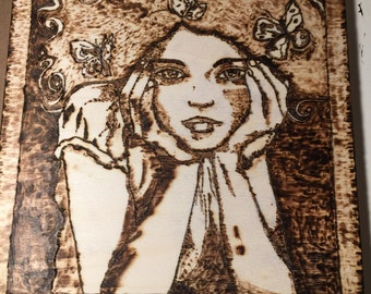 Wood-ash girl with butterfly