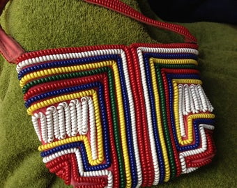 Vintage multicolored telephone cord handbag with different designs front & back