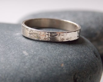 Silver ring for woman. hammered and customizable ring tube n. 1