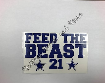 "Feed The Beast - Dallas Cowboy Zeke Elliott Decal - Windows, Vehicles, Walls, Golf Carts - 7"" x 5"""