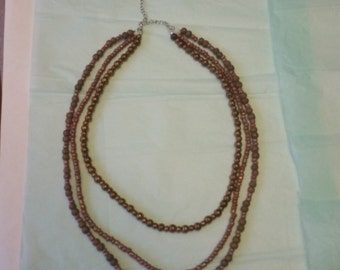 19 inch bronze and pink beaded 3 strand necklace
