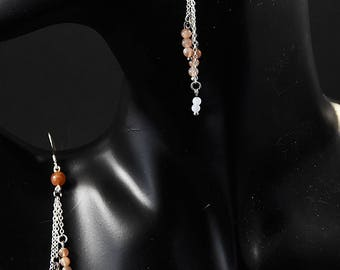 Earrings in chalcedony and stones of Sun