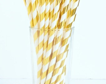 20 striped or polka-dotted paper straws in gold or silver
