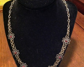 Chain necklace with filigree flowers and red bead crystal accents