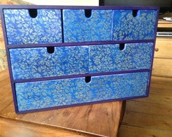 Blue and purple set of draws
