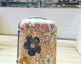 Hard plastic trolley hand decorated, floral design, available in different sizes.