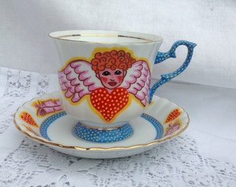Handpainted vintage Cupid cup, saucer and tea plate. Porcelain.