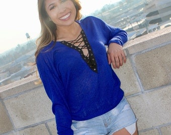 Blue sweater lace up