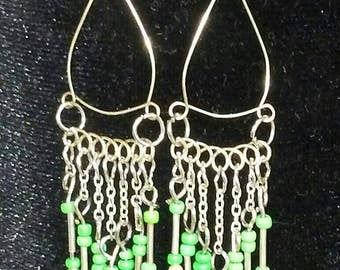 Silver chandelier earrings with green seed beads