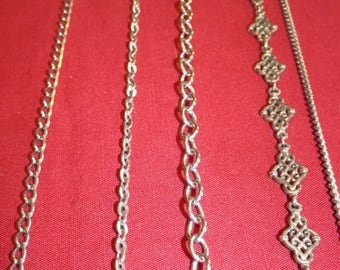 4 Silver colored chain necklaces