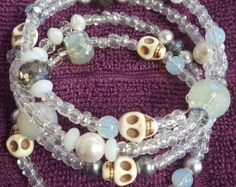 4 strands of glass and milk glass with a side of fright memory wire bracelet.