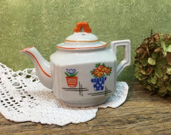 Small Porcelain Teapot/Made in Japan/White/Orange Trim