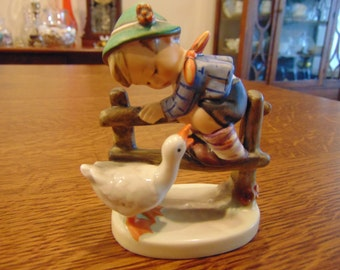 Hummel Figurine of Boy Climbing Fence with Duck (free shipping)