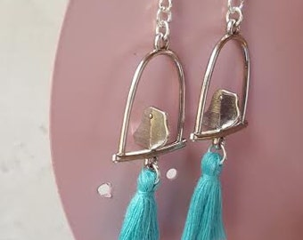 Swings to birds and tassels earrings
