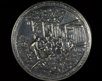 Danish Hans Jensen early silver repousse compact, stamped Denmark with the Whale