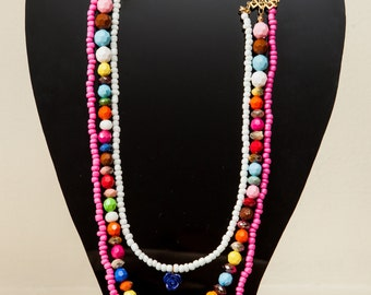 Triple and colorful beaded necklace.
