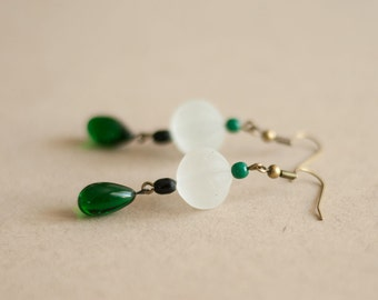 Vintage earrings made of old glass beads, translucent and green