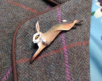 Hand painted 'Leaping Hare' brooch, with silver coloured heart detail attached
