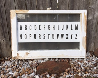 Vintage window with English alphabet