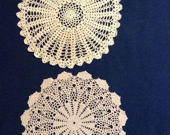 Vintage off white and beige doilies, one thread crochet and one tatted, in lacy patterns.
