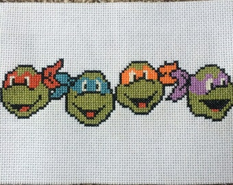 Teenage Mutant Ninja Turtles Cross Stitch piece (unframed).