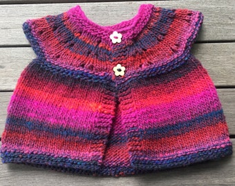 Baby cardigan with wooden flower buttons, size newborn to 6 months. Made from beautiful Noro Kureyon 100% wool.