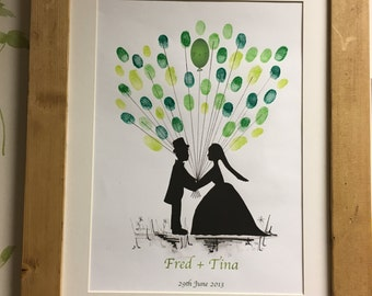 Happy couple fingerprint guestbooks, weddings