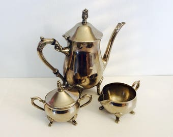 Set includes teapot, sugar bowl and creamer silver plated