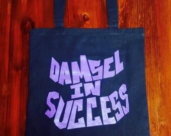Damsel in Success Tote Bag