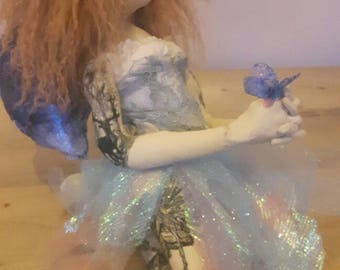 Tattooed Fairy princess  soft sculpture art cloth doll OOAK, with  blue corset dress and soft wavy hair, kneeling holding a butterfly