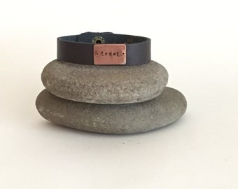 Hand stamped copper and leather 'trout' bracelet