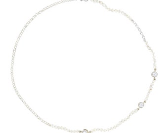 Freshwater cultured white pearl necklace featuring cubic zirconia sections and silver chain