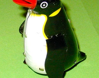 penguin tin wind up metal mechanical toy works perfect rare collectible