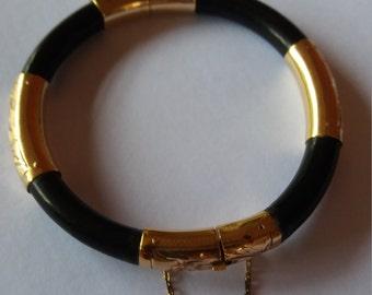 Antique 14k gold and blackwood bangle.