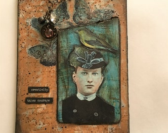 Mixed media art collage woman with bird on her hat in blues