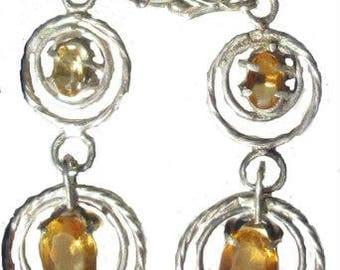 Handmade silver earrings with precious topaz