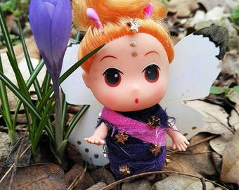 Baby Doll dresses up as a butterfly Dollhouse