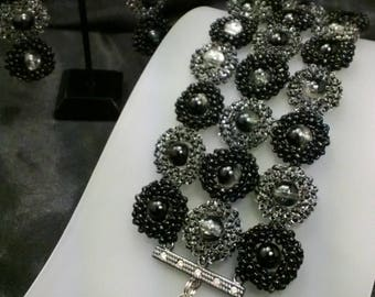 Silver/Black circular pattern, seed beads with glass beads bracelet with earrings