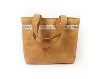 Camel suede bag with Brown, purple and gold curly Ribbon.